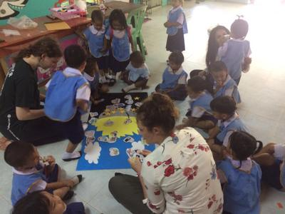 Andrea playing with the children at a day care centre