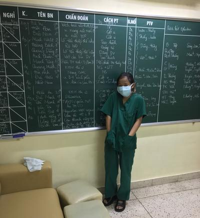 Angela poses in her scrubs in Vietnam