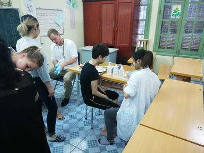 Medicine interns working on health checks in Vietnam