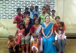With other volunteers and children