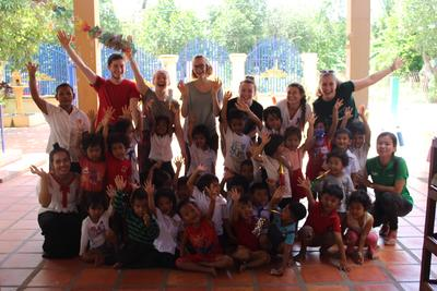 Volunteers and children from a local kindergarten in Cambodia