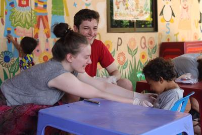 Volunteers spend time with children during a healthcare outreach