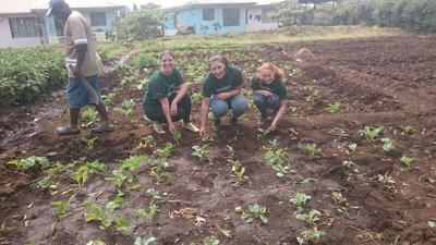 Volunteers help plant a garden at a Tanzanian orphanage