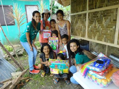 Building volunteers with the toys they donated to the kids