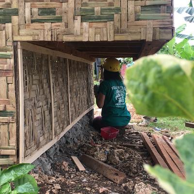 Bushra working on a house