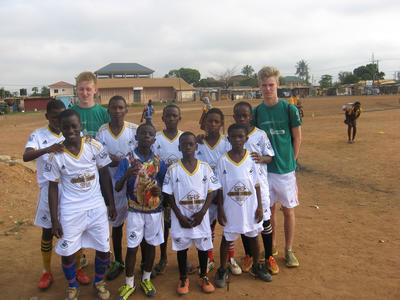 Volunteers and the boys of the soccer club