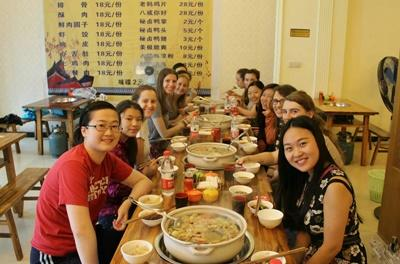 Volunteers enjoying a meal at a local Chinese restaurant