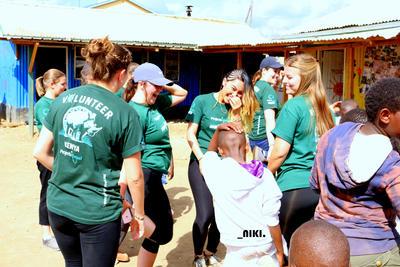Volunteers having fun with local children