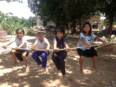Children play during their break time at school