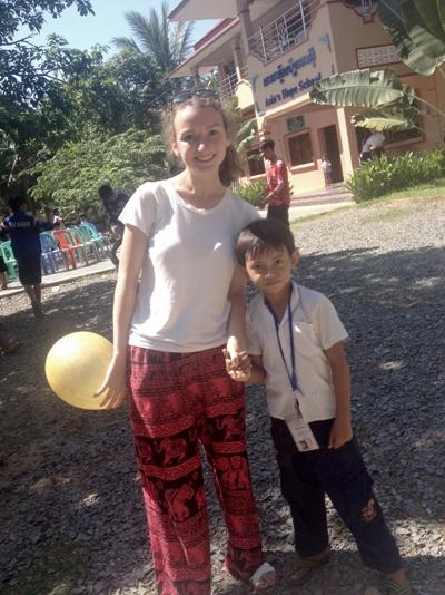 Chloe and one of the children at Asia's Hope