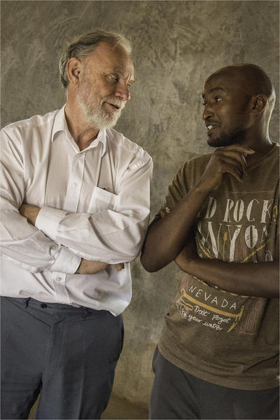 Christopher and a local man in Kenya