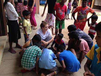 Children with a volunteer in Sri Lanka