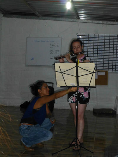 Volunteers playing music during a cultural evening