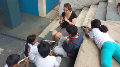 A Music volunteer teaching children in Ecuador