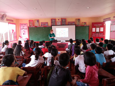 Ellie Jane Waite teaching the children about how to be healthy during school