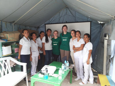 Volunteers and staff in the tent during their medical mission at the city health office