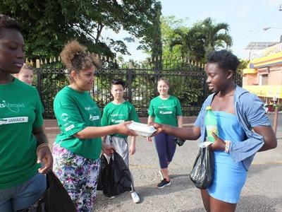 Volunteers hand out food in Jamaica