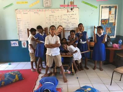 Emily and local school children working together in a classroom