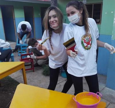 Volunteers repainting the school walls