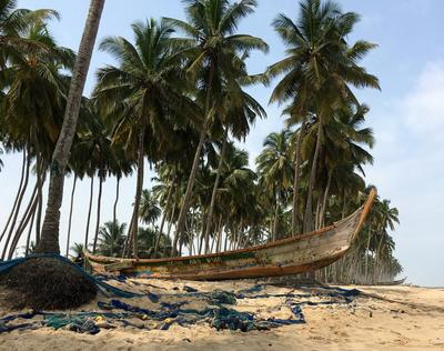 A boat on the shore in Ghana