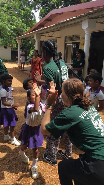Dentisrty volunteers playing with the children in Sri Lanka