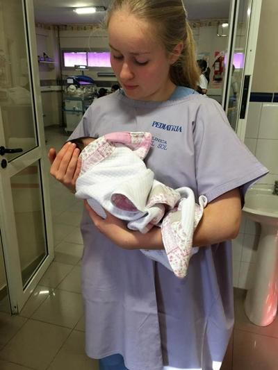 Holding a newborn baby at a hospital in Argentina