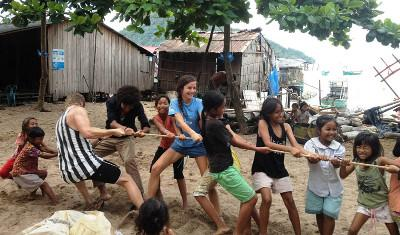 Volunteers playing games at an orphanage in Cambodia