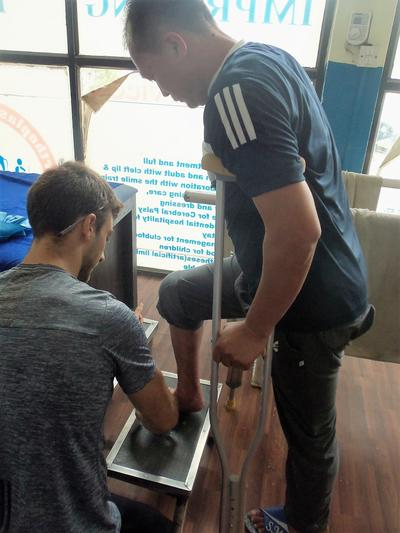 A volunteer assists at his Physiotherapy placement