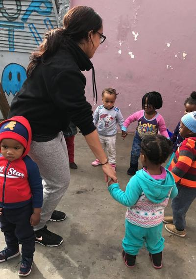 Heidi playing games with young children in South Africa