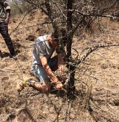 Jake removing a snare in the Soysambu Conservancy