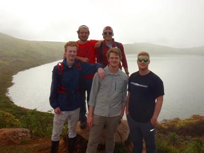 Male volunteers exploring the Galapagos Islands