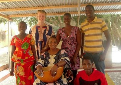 Volunteer and host family in Senegal