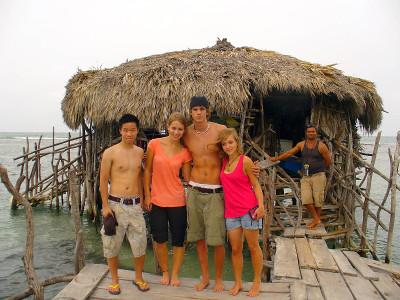 Volunteers outside a traditional house