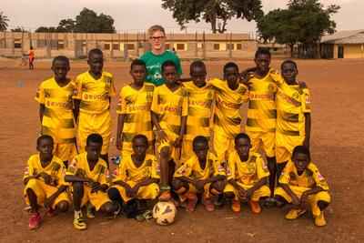 Josh with his football team in Ghana