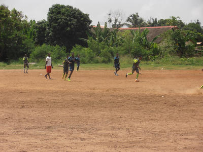 Local players during a football game in Ghana