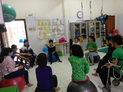 Occupational Therapy volunteer working with the locals at the community village in Hanoi