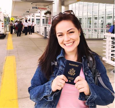 Katrina with her passport as she prepares to travel to Romania