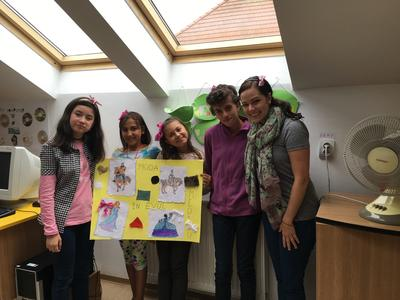 Romanian children presenting a project on the history of fashion