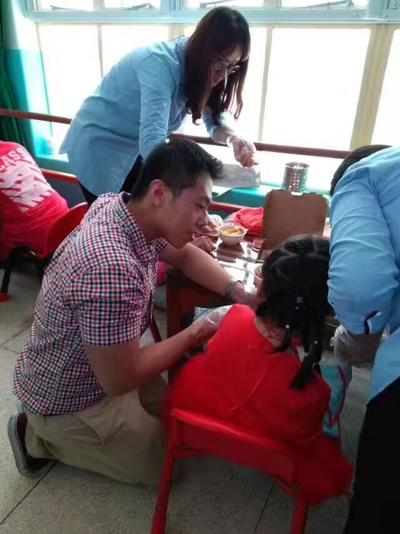 Kevin working with a young girl at the centre