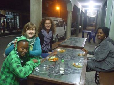 Volunteers enjoying a meal in Tanzania