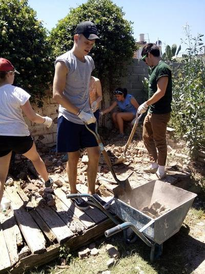 Volunteers assisting with building work