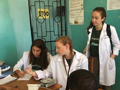 Volunteer assist at a screening outreach in Tanzania