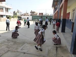 Children skipping at the Teaching project
