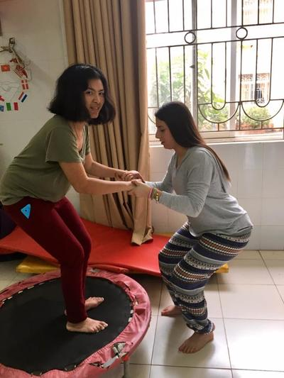 A volunteer helps provide occupational therapy treatment in Vietnam