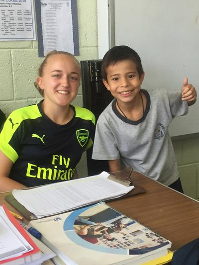 May with one of her students at the school