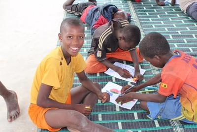 The children in Senegal busy with a classroom activity