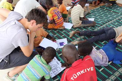 Volunteers working the children in Senegal