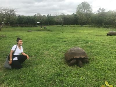 Melike with a giant tortoise in Ecuador