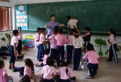 Volunteer teaching in a school in Thailand