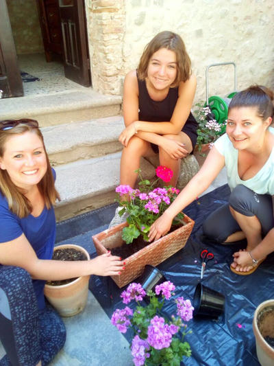 Volunteers doing gardening at the Refugee Project